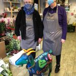 Two florists with goat model painted Save our Planet