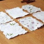 Squares of handmade paper illustrating a paper making workshop.